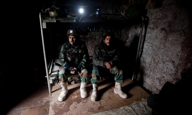 Indian army soldiers rest inside a bunker near the line of control that divides Kashmir between India and Pakistan, in Silikot, north of Srinagar. Pakistan accused Indian troops of killing one of its soldiers along the disputed Kashmir border, in the latest of a series of tit-for-tat attacks that threaten to raise tensions between the neighbours