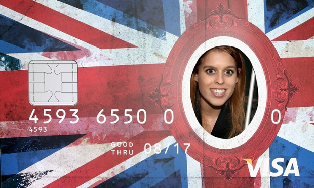 Using daddy's credit card? Princess Beatrice peers through a giant credit card as she visits the e-commerce company Zalando in Berlin as part of a two-day trip funded by their father, Prince Andrew
