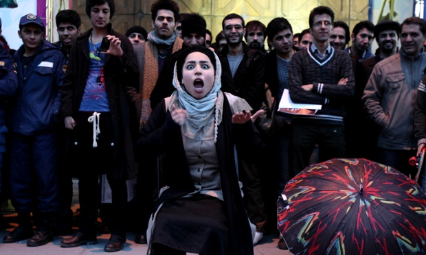 Iranian actress Elaheh Pourjamshid performs her role as a mother in Awakening of The Particles street theatre, telling a story about children's education, during the 31st Fajr international theatre festival, in Tehran.