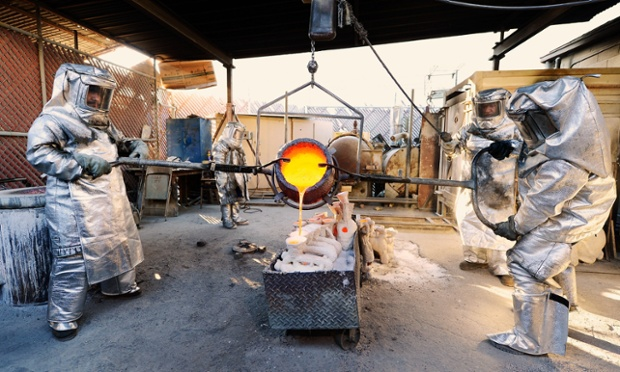 Casting awards: Adalid Orozco (L) Daniel Flores (R) pour molten bronze metal into molds during the casting of the Screen Actors Guild Award statuettes in Burbank, California. The 19th Annual SAG Awards, which honors outstanding motion picture and primetime television performances are to be held in Los Angeles on January 27. Photograph: Kevork Djansezian/Getty Images