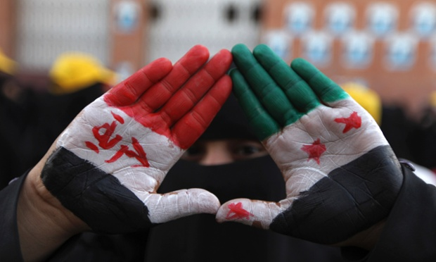 A pro-democracy protester displays her palms that are painted with the national colours of Syria during a demonstration in Sanaa, Yemen. The demonstrators were calling for Yemen's President Abd-Rabbu Mansour Hadi to make more decisions to complete the preparations for national dialogue and to demand that Yemen's former president Ali Abdullah Saleh be put on trial.