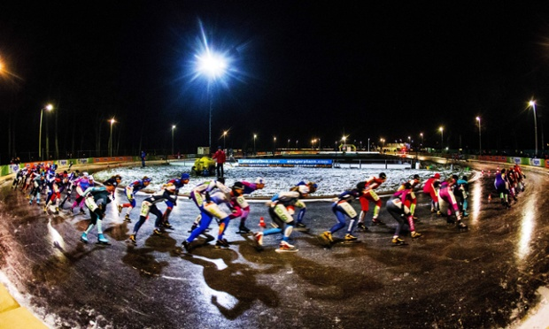 The women's pack in action during the third marathon on natural ice at the ice rink of skating club in Gramsbergen, Overijssel, The Netherlands.