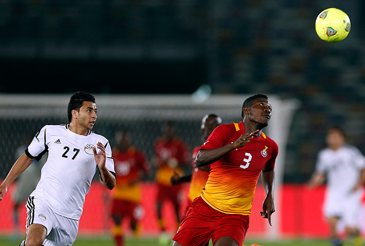 African Nations: Egypt's Basem Ali fights for the ball against Ghana's Asamoah Gyan