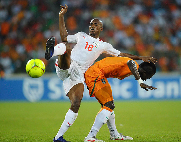 African Nations: Charles Kabore of Burkina Faso vies with Cheik Tiote of Ivory Coast