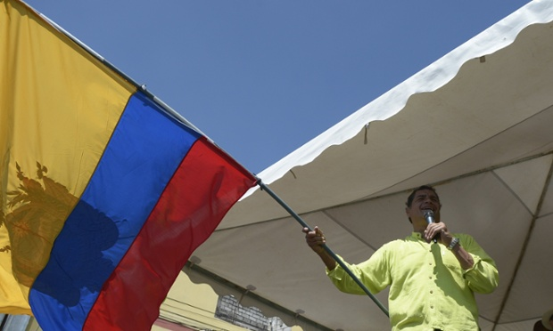 Ecuador's president and presidential candidate Rafael Correa, waves an Ecuadorean flag as he speaks during a campaign rally in Machachi. Polls show Correa, a leftist who has been in office since 2007, is the overwhelming favorite to win in the first round of voting.