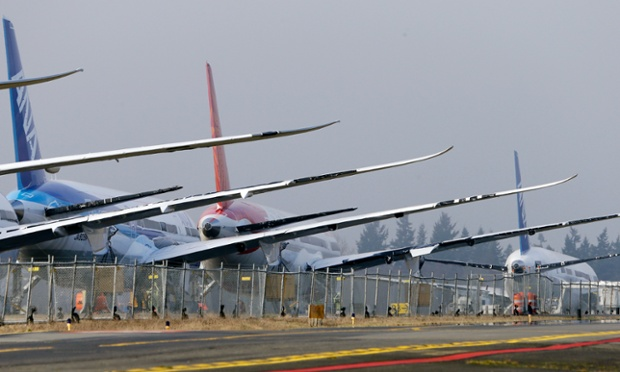 Tails and wings stand out in a line of 787 jets parked nose-to-tail at Paine Field in Everett, Wash. Federal officials say they are temporarily grounding Boeing's 787 Dreamliners until the risk of possible battery fires is addressed.