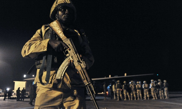 A soldier stands guard as Nigerian troops arrive at the airport in Bamako. Over one hundred Nigerian and Togolese soldiers arrived in Bamako today as part of the West African force meant to help French troops chase Islamists from their strongholds in northern Mali.