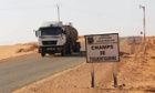 A lorry passes a sign for the Tiguentourine gas plant in In Amenas, Algeria, where Islamist militants are holed up.