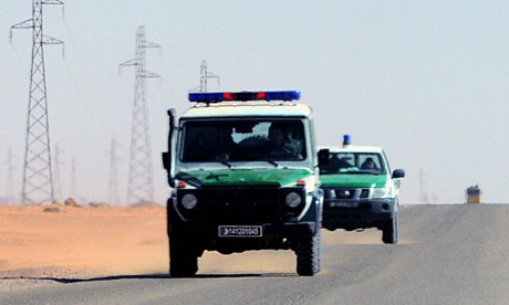 Algerian security forces drive through the desert near the In Amenas gas plant