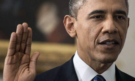 US President Barack Obama is sworn in for a second term in the Blue Room of the White House