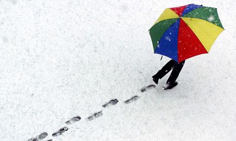 Pedestrian walks across snow in Davos