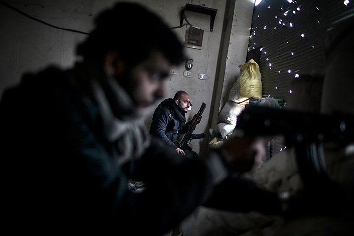 24 hours: Aleppo, Syria: Free Syrian Army fighters hold their weapons during clashes
