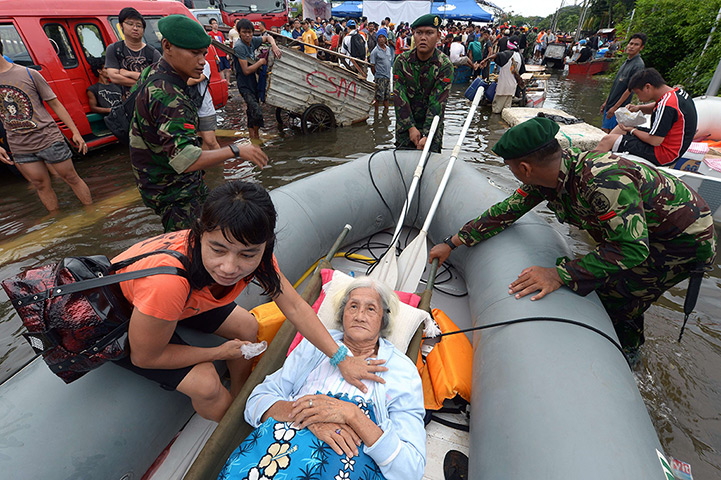 24 hours: Jakarta, Indonesia: An ailing 87-year-old woman lies in a boat