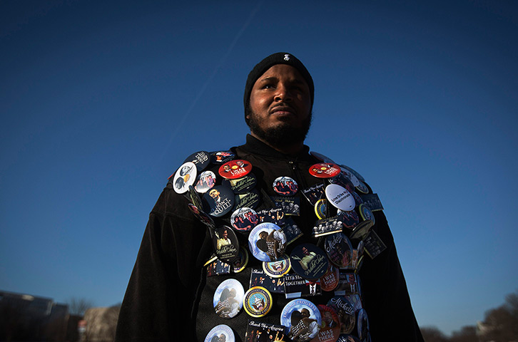 24 hours: Washington, US: A man wears a jacket covered with badges