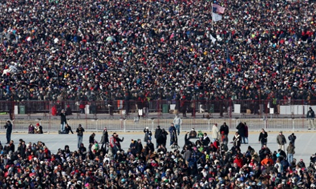 Crowds gather as they await for the start of the presidential inauguration.