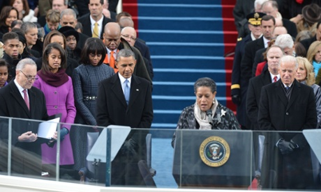 Barack Obama listens to the invocation by Myrlie Evers-Williams