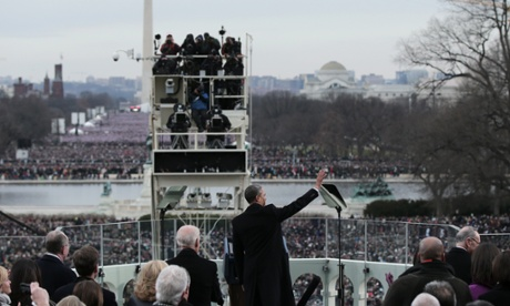 Barack Obama waves to crowds.
