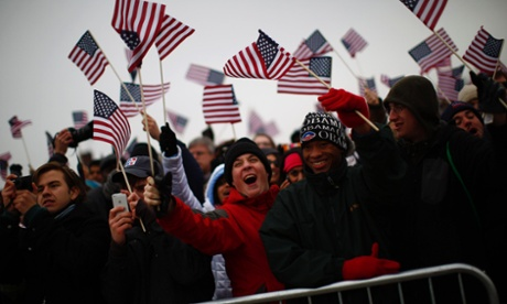 Spectators react to Obama's speech on the Mall.