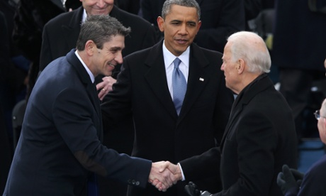 Poet Richard Blanco (left) is greeted by Joe Biden Barack Obama