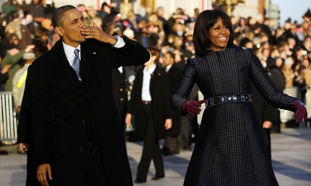 President Barack Obama blows a kiss as he and first lady Michelle Obama walk on Pennsylvania Avenue.