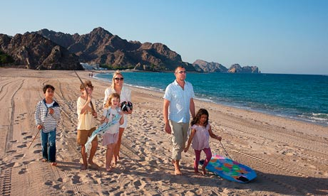 Helen Fielding and Chris Hallatt Wells with their children in Oman