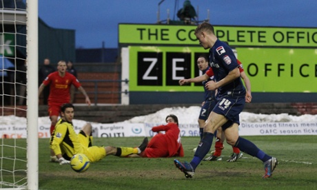 Smith is on hand to score Oldham's second.