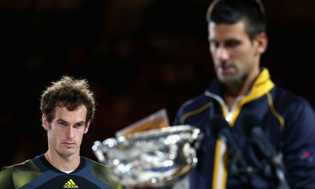 Andy Murray watches Novak Djokovic pick up the trophy.