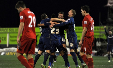 Reece Wabara is mobbed by team-mates.