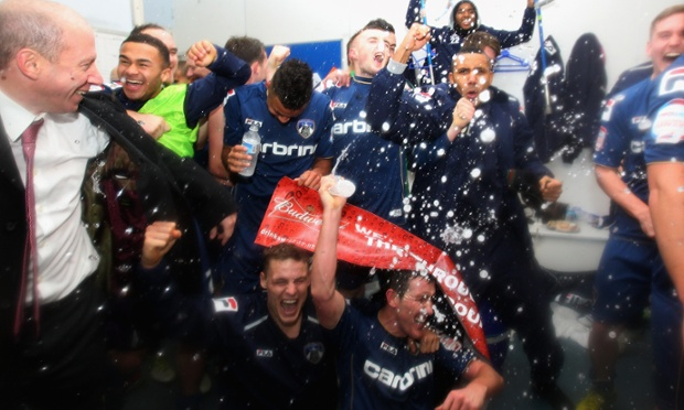 Oldham players celebrate victory after the match.