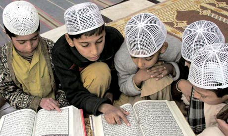 Pakistani students recite the Koran