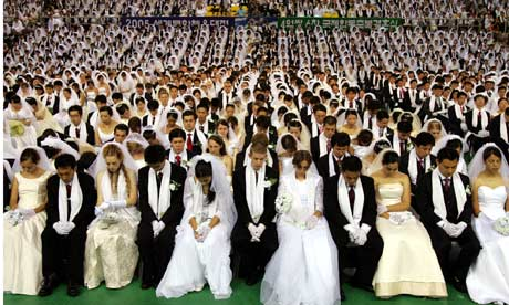 About 4,600 couples, some from foreign countries, pray during a mass wedding ceremony in Korea