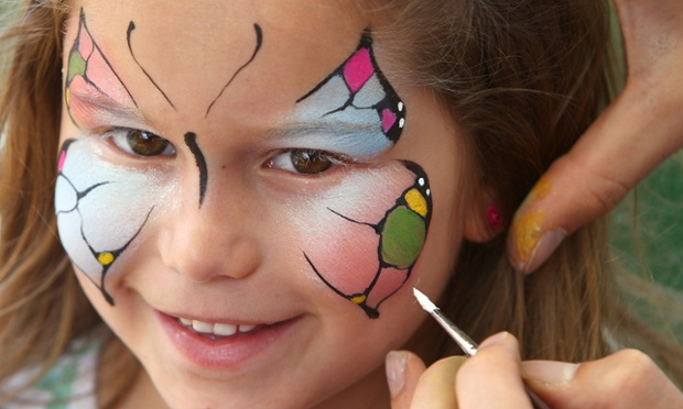 A young cricket fan has her face painted like a butterfly in Australia colors during day one of the Third Test match between Australia and Sri Lanka at the Sydney Cricket Ground.
