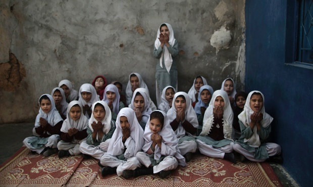 Schoolgirls, displaced from Pakistan's tribal areas due to fighting between militants and the army, pray in tribute to the five female teachers and two aid workers who were killed by gunmen at a school on the outskirts of Islamabad. Gunmen in northwest Pakistan killed the teachers and aid workers in an ambush on a van carrying people home from their jobs at a community center.