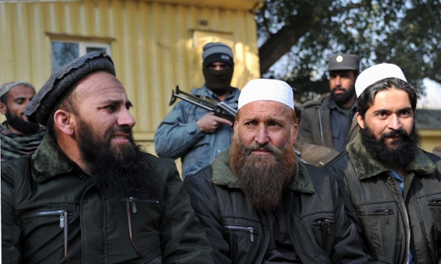 Former Afghan prisoners are photographed during a ceremony in Jalalabad following their release from Bagram Prison. Twenty former Taliban members who were detained during operations by US and Afghan forces, were released as part of a government-backed programme offering amnesty to former Taliban insurgents who agree to renounce violence.