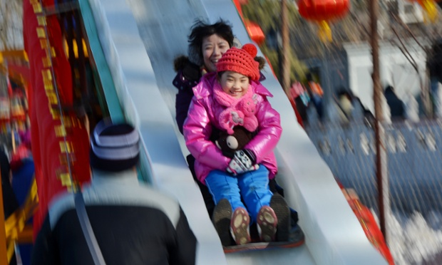 This family are on a slippery slope...enjoying an ice slide at the frozen Houhai Lake in Beijing.  The lake attracts scores of tourists and locals during the winter for skating and ice swimming despite temperatures of up to minus 18 Celsius.