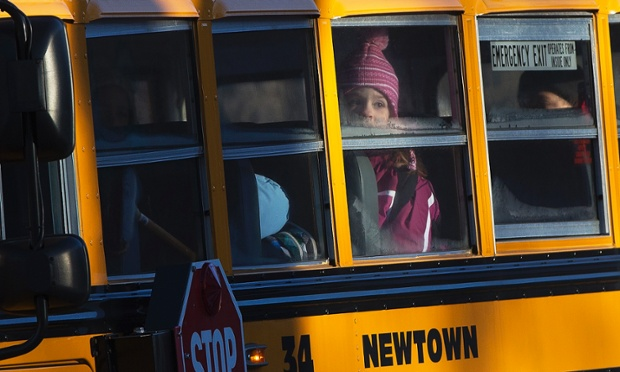 Bus no. 34 from Newtown takes the children from Sandy Hook Elementary School to their new premises in the neighbouring town of Monroe in Connecticut. Hundreds of the children who escaped the harrowing attack at their school last month have returned to classes today.