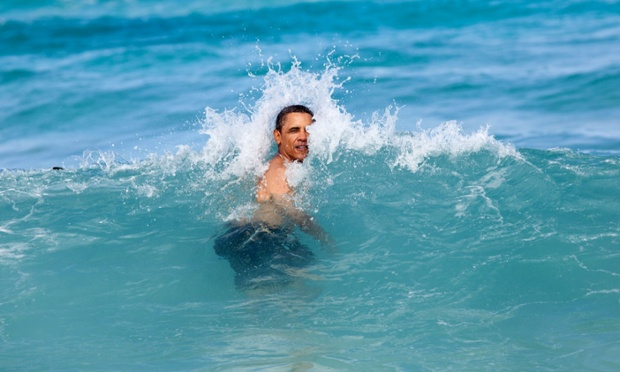 An image just released by the White House shows President Barack Obama jumps into the ocean at Pyramid Rock Beach in Kaneohe Bay, Hawaii on January 1st. It would seem that a president sometimes has to swim against the tide even on holiday.