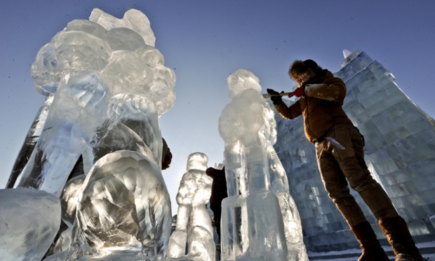 A contestant crafts an ice sculpture during the International Ice Assemblage Sculpture Championship in Harbin, China. A total of 15 teams including those from The Netherlands, Russia and South Korea took part in the championship. A sculpture by contestants from China's Harbin University claimed the first prize.