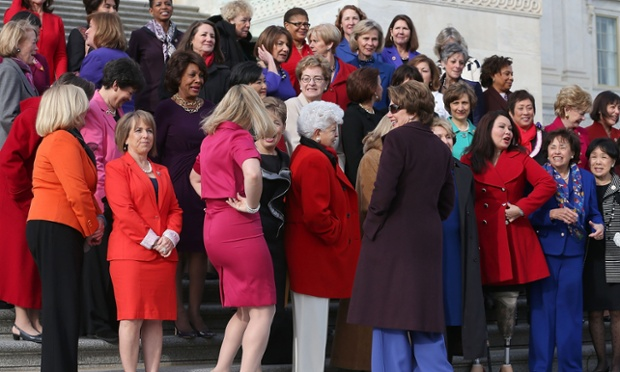 Democratic Leader Nancy Pelosi greets the women of the House Democratic Caucus during a photo opportunity in Washington, DC. The press event is intended to highlight the increased number of women in the house ahead of the 113th Congress being sworn in today