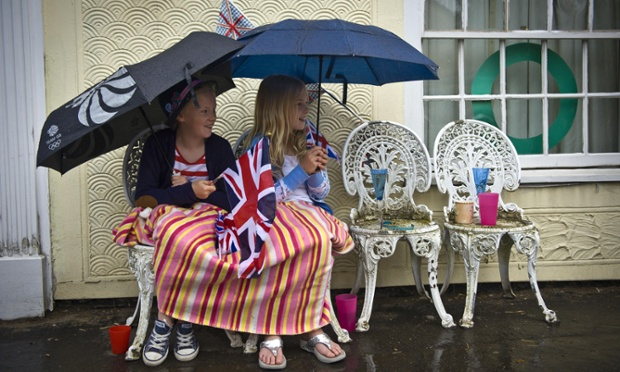Wet Wet Wet was the was the weather story of 2012. Met office figures show that last year was the second wettest in the UK on record. This was a familiar scene: children sheltering from the rain as they wait for the Olympic Flame to pass through Newport during the torch relay in July. See more from the year in our gallery.