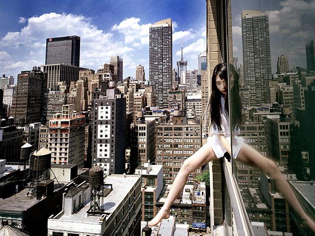 Ahn Jun self-portraits: A self portrait of Jun Ahn dangling from a skyscraper