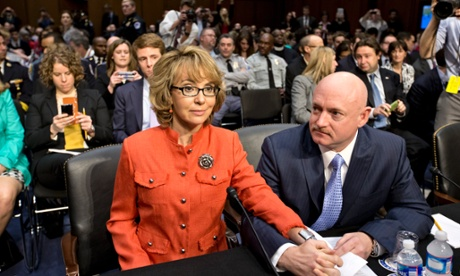 Former Arizona Representative Gabrielle Giffords, who was seriously injured in the mass shooting that killed six people in Tucson, Arizona two years ago, sits with her husband, Mark Kelly on Capitol Hill in Washington. Giffords is speaking before the Senate Judiciary Committee hearing on what lawmakers should do to curb gun violence in the wake of last month's shooting rampage at that killed 20 schoolchildren in Newtown.