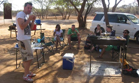 Shiraz Chakera, right, enjoys a barbecue with friends at the Gabs game reserve in Botswana.