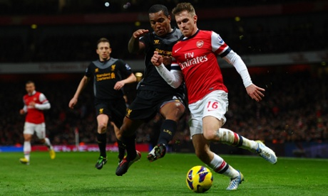 Arsenal's Aaron Ramsey and Andre Wisdom of Liverpool compete for the ball at the Emirates Stadium.
