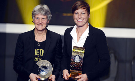Pia Sundhage, left, and Abby Wambach pose with their Fifa awards