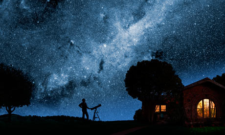 A man gazes at the Milky Way outside his house at night