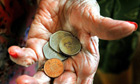 Social care funding gap, woman with coins