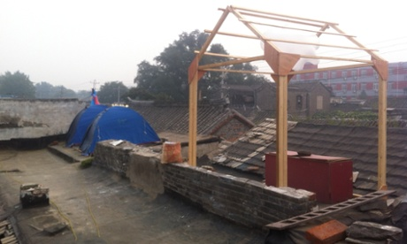 Out in the cold … Taiwanese architects Open Union Studio are camping on the rooftop after local residents refused them access.