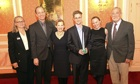 Edward Snowden, holding the Sam Adams award for integrity in intelligence, in Russia