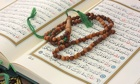 Holy Quran with wooden rosary
